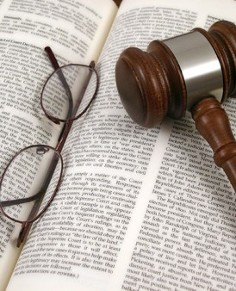 Book with Glasses and a Gavel - Business Attorney